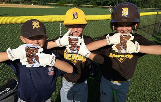 youth players with Bear Down gloves